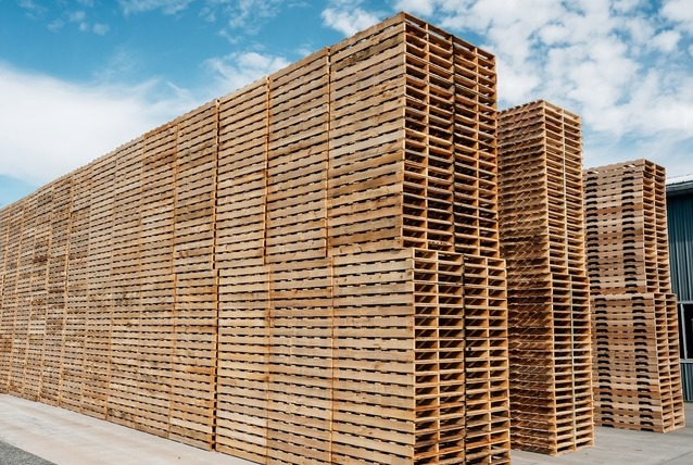 new wooden pallets in high stacks