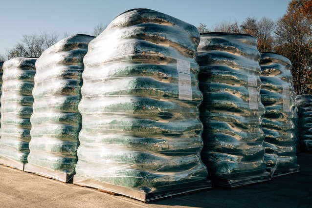 stacks of mulch made from recycled pallets